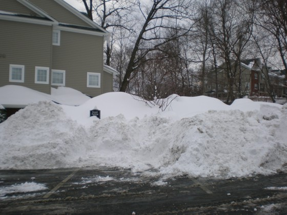 Snow piled high in the parking lot