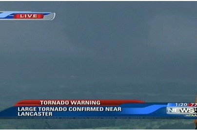 Screen capture from a live Dallas, TX news feed of Lancaster (south Dallas) tornado on April 3, 2012.