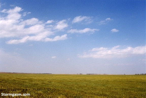 Photo from May 22, 2002 near Dodge City, Kansas.  The CAP was just too strong on this day, leaving partly cloudy skies above an open field in western Kansas.