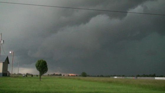 Looking west from somewhere well south of Joplin at a tornado producing supercell (rain wrapped).