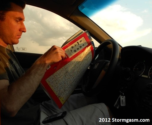 Jim looking at the map after deciding to drop south for another cell.